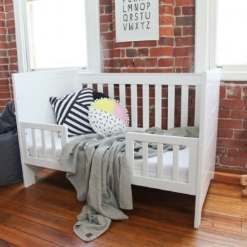white baby cot that coverts to a toddler bed