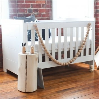 white cot that converts from a bassinet, cot, toddler bed and day lounge