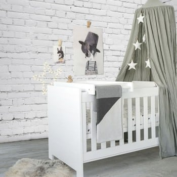 white cot that can be used for up to 5 years. Start as a cot for a newborn and convert to a toddler bed and day lounge as your child grows.