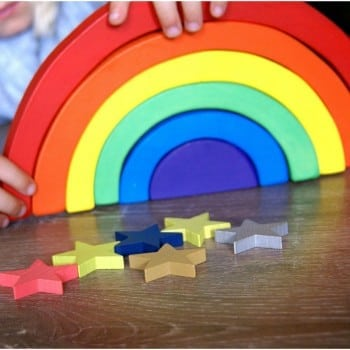 wooden rainbow for exploring and creating symmetry, colour, balance and creative play
