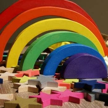 wooden rainbow blocks for symmetry, balance, colour, textures and creative play