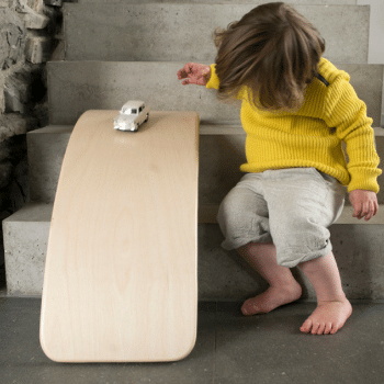 wobbel rocking board can be used for imaginative play or developing gross motor skills