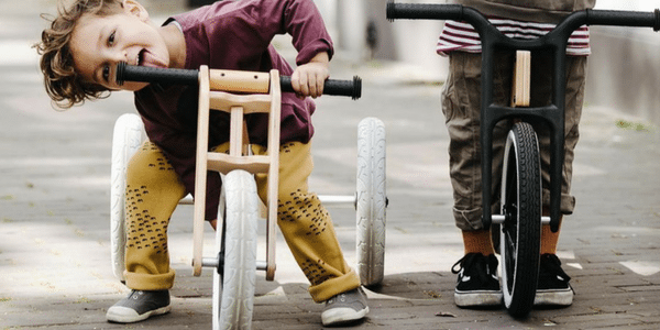 wishbone bike comes in wooden and recycled carpet